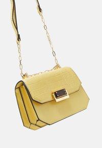 ALDO - FELLE - Across body bag - light yellow - 3