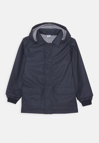 FATAH CIRE UNISEX - Waterproof jacket - smoking