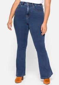 Sheego - Bootcut jeans - blue denim - 0