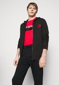 HUGO - DEASTY - Pantaloni sportivi - black - 3