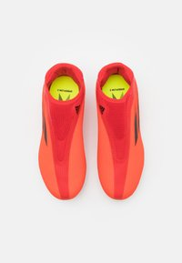 adidas Performance - X SPEEDFLOW.3 FIRM GROUND UNISEX - Moulded stud football boots - red - 3