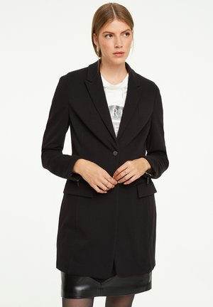MIT REISSVERSCHLUSS-DETAIL - Short coat - black