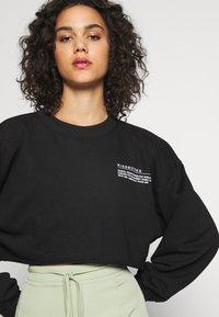 Missguided - CROPPED RAW HEM - Sweatshirt - black - 4