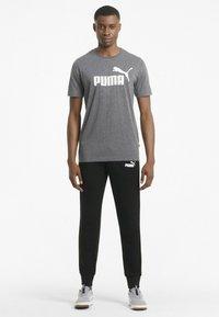 Puma - Tracksuit bottoms - puma black - 1