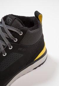Salomon - UTILITY FREEZE CS WP - Winter boots - black/empire yellow - 5