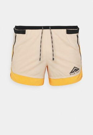 TRAIL - Sports shorts - solar flare/beach/black