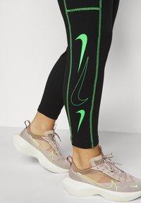 Nike Sportswear - Leggings - Trousers - black/poison green - 4