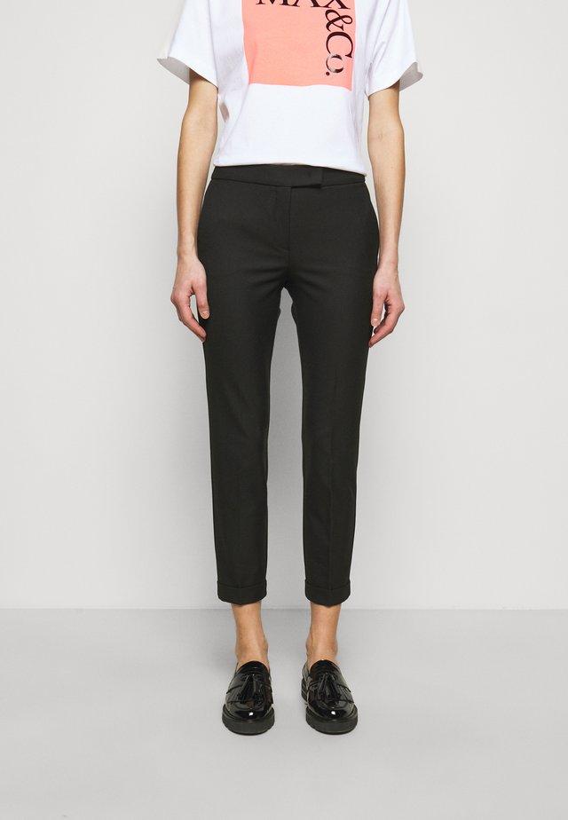 MONOPOLI - Trousers - black