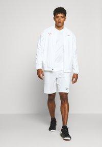 Nike Performance - FLX ACE - Sports shorts - white/black - 1