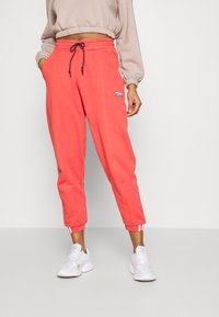 adidas Originals - Tracksuit bottoms - coral - 0