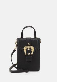 GRANA BUCKLE CROSSBODY - Handbag - nero