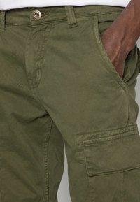 Alpha Industries - Cargo trousers - dark oliv - 4