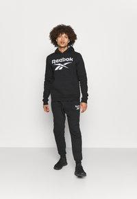 Reebok - HOODIE - Sweatshirt - black/white - 1