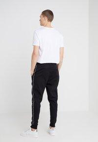 HUGO - DRAPANI - Pantalon de survêtement - black - 2