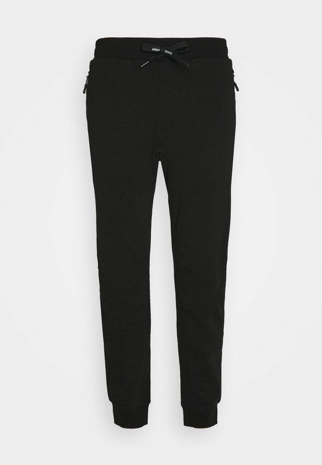 TROUSER - Pantalones deportivos - black