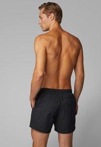 BOSS - OCTOPUS - Swimming shorts - black - 3
