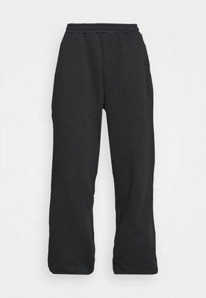 NA-KD X ZALANDO EXCLUSIVE - LOOSE FIT PANTS - Tracksuit bottoms - black