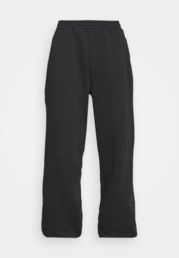 NA-KD X ZALANDO EXCLUSIVE - LOOSE FIT PANTS - Träningsbyxor - black