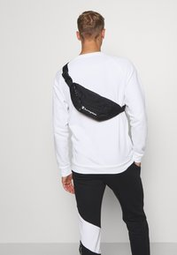 Champion - LEGACY BELT BAG - Sac banane - black - 0
