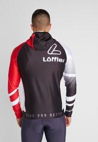 LÖFFLER - HOODY WORLDCUP - Sportovní bunda - black/red - 2