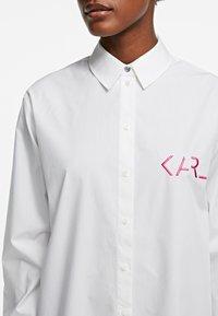 KARL LAGERFELD - LEGEND - Button-down blouse - white - 4