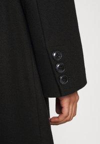 NA-KD - MATHILDE GØHLER BLEND COAT - Klasický kabát - black - 5