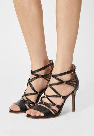NITIPA - Sandals - noir