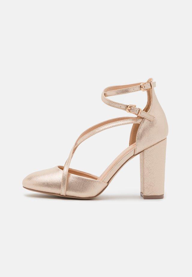 CASH - High heels - gold