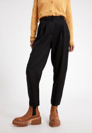 ARETAA - Trousers - black