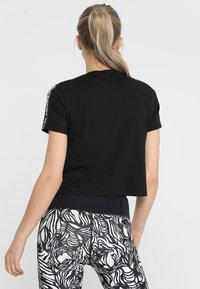 Superdry - CORE CROP BRANDED TEE - Print T-shirt - black - 2