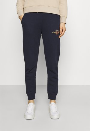 ARCHIVE SHIELD PANT - Tracksuit bottoms - evening blue