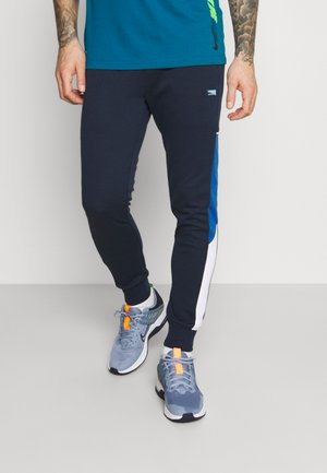 JJIWILL JJCARLING PANTS - Tracksuit bottoms - navy blazer