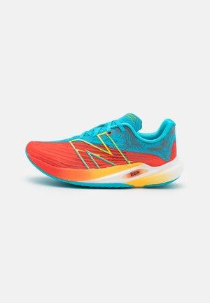 FC REBEL - Tekmovalni tekaški čevlji - orange