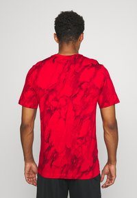 Nike Performance - TEE - Printtipaita - university red - 2