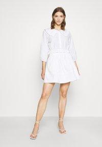 Monki - MILDA BLOUSE - Button-down blouse - white - 1