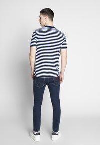 Calvin Klein - STRIPE CHEST LOGO  - Print T-shirt - blue - 2