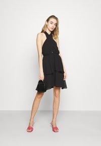 Gina Tricot - EXCLUSIVE MALVA HALTERNECK DRESS - Koktejlové šaty/ šaty na párty - black - 1