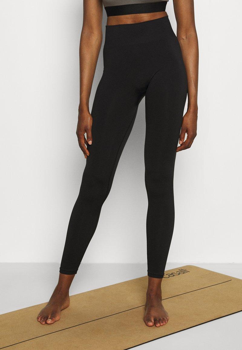 ARKET - Leggings - black