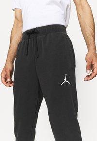 Jordan - AIR PANT - Tracksuit bottoms - black/white - 3