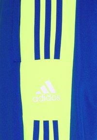adidas Performance - SQUAD - Tracksuit bottoms - team royal blue/team solar yellow - 5