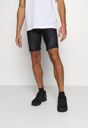 EXO ADAPT SHORT - Medias - black
