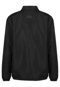 Umbro - FC SCHALKE 04 COACH HERREN - Light jacket - black - 1