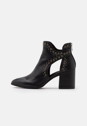 JASTINA - Ankle boots - black