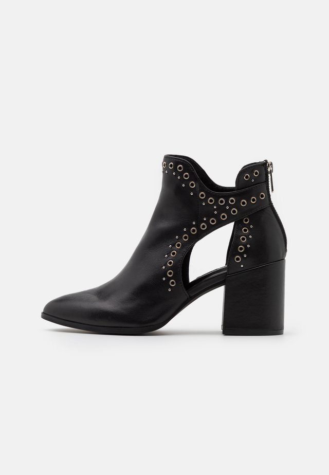 JASTINA - Ankle boot - black