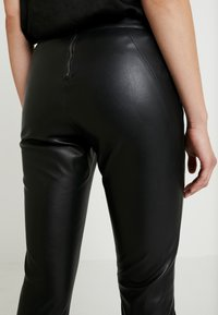 ONLY - ONLSIA PANT - Trousers - black - 5