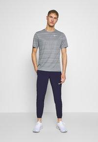 Nike Performance - ESSENTIAL PANT - Verryttelyhousut - imperial purple/reflective silver - 1
