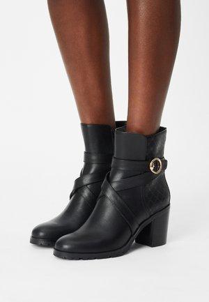 HAIMOUNA - Kotníkové boty - black