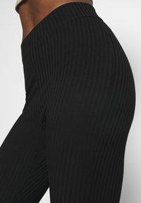 Hey Honey - FLARED PANTS - Tracksuit bottoms - black - 4