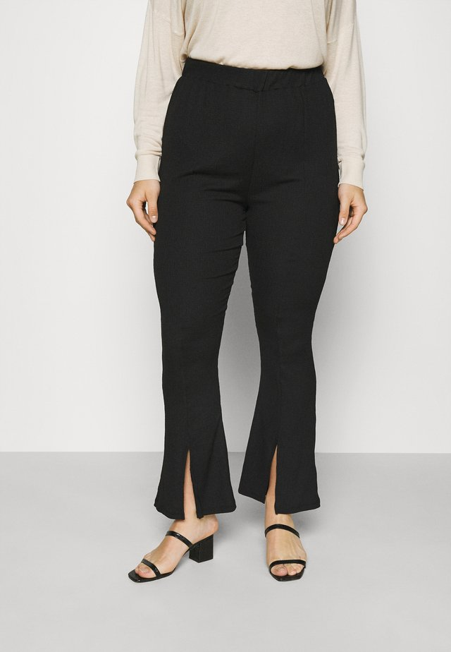WAFFLE TEXTURED FRONT SPLIT FLARED TROUSERS - Pantalones - black