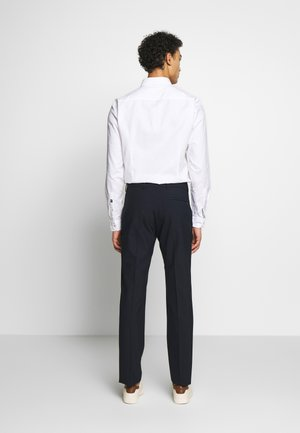 TRAVEL TAILORED - Trousers - bright navy